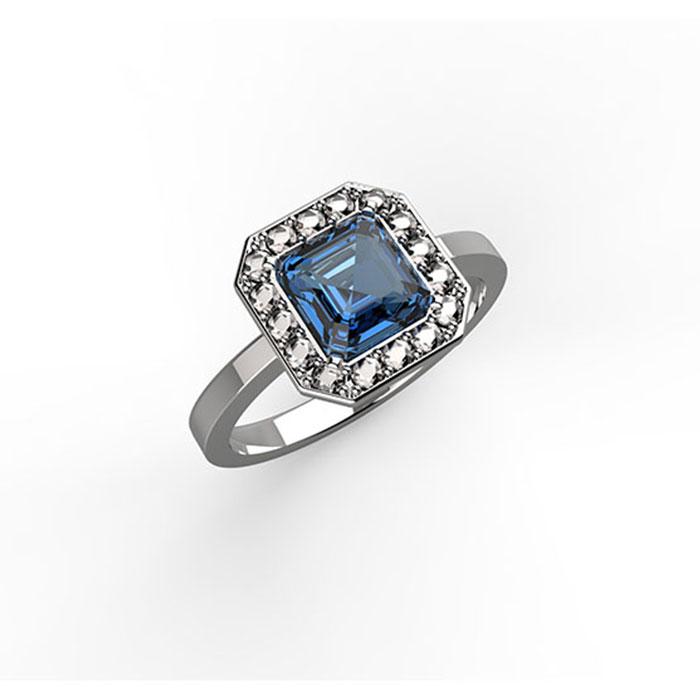 anello in oro bianco o platino con diamanti e zaffiro