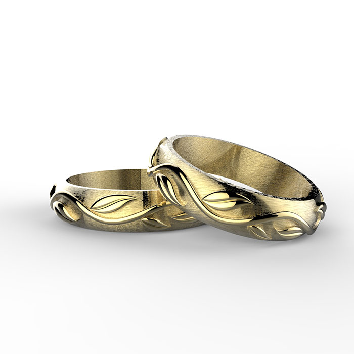 fedi nuziali in oro giallo con ghirlanda decorativa a rilievo