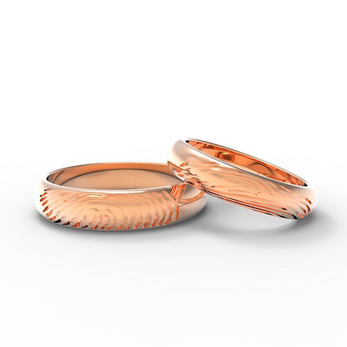 fedi nuziali in oro rosa personalizzate con impronte digitali personali