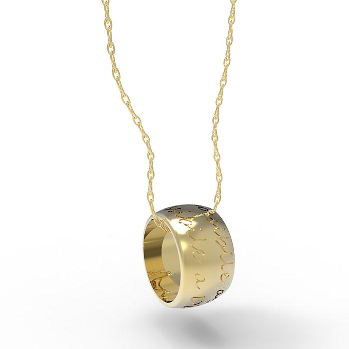 ciondolo in oro giallo con incisioni interne ed esterne personalizzabili