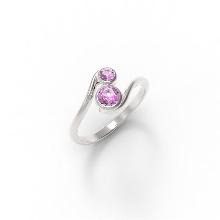 anello in oro o platino con due pietre preziose