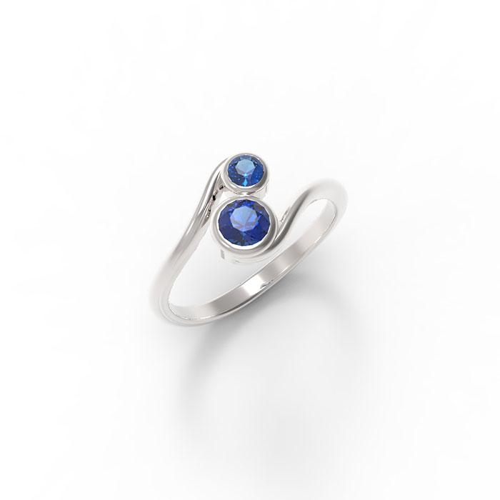 anello contrariè con due pietre preziose in platino o oro